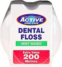 Parfémy, Parfumerie, kosmetika Mátově ochucená zubní nit - Beauty Formulas Active Oral Care Dental Floss Mint Waxed 200m