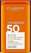 Parfémy, Parfumerie, kosmetika Opalovací tyčinka pro citlivé oblasti obličeje - Clarins Stick Solaire Invisible SPF50