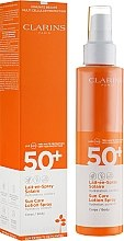Parfémy, Parfumerie, kosmetika Mléko proti opalování - Clarins Lait-en-Spray Solaire Corps 50+