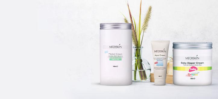 K nákupu krému pod plenky a multifunkčního tělového mléka Mediskin získej tělový krém jako dárek