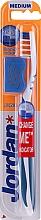 Parfémy, Parfumerie, kosmetika Zubní kartáček středně tvrdý + ochranný kryt, tmavo modrý - Jordan Advanced Medium